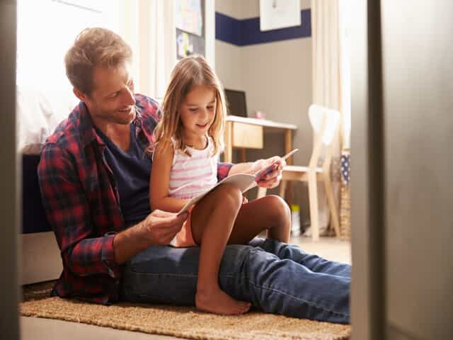 Father reading to daughter representing child custody